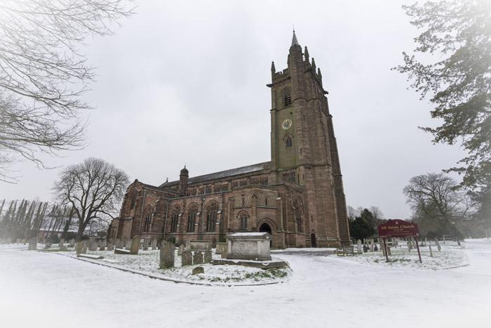 Snow scene featuring All Saints Church
