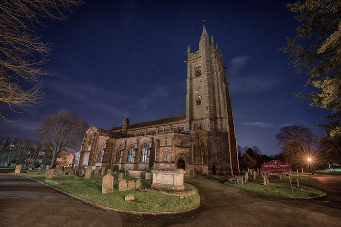 All Saints Church on a moonlit night