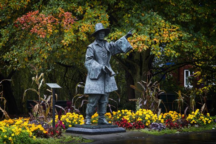 Statue of Samuel Stone in autumn