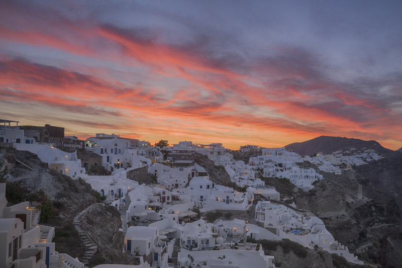 Oia beneath orange skies at dawn