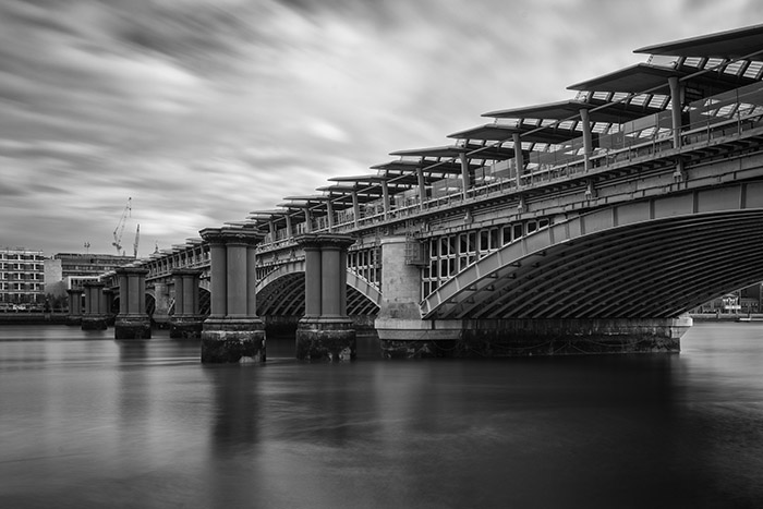 Black and white photo of Blackfriars Railway Bridge