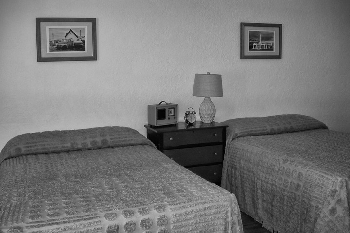 Framed photographs of Route 66 in Missouri as bedroom artwork at the Boots Motel on Route 66 in Carthage