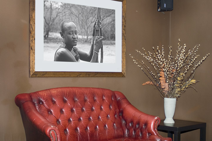 Framed photograph of African tribesman at the bar in the Hendon Hall Hotel in London
