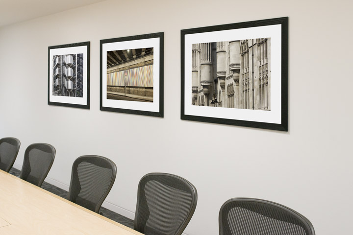 Framed pictures of London artwork in offices of London Finance Company