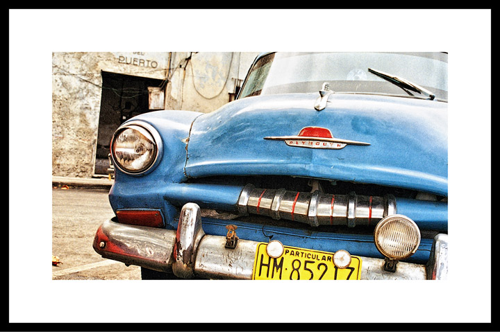 Framed photograph of car in Cuba in offices of Russell Reynolds