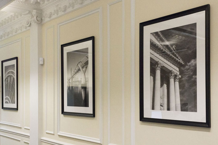 Black and white framed photographs of London in the offices of SDCL in London