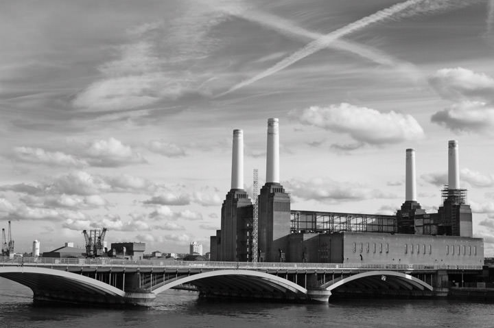 Battersea Power Station beneath a dramatic sky in black and white