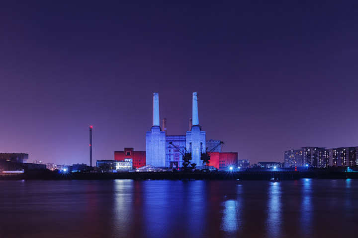 Battersea Power Station floodlit in blue and purple at Night
