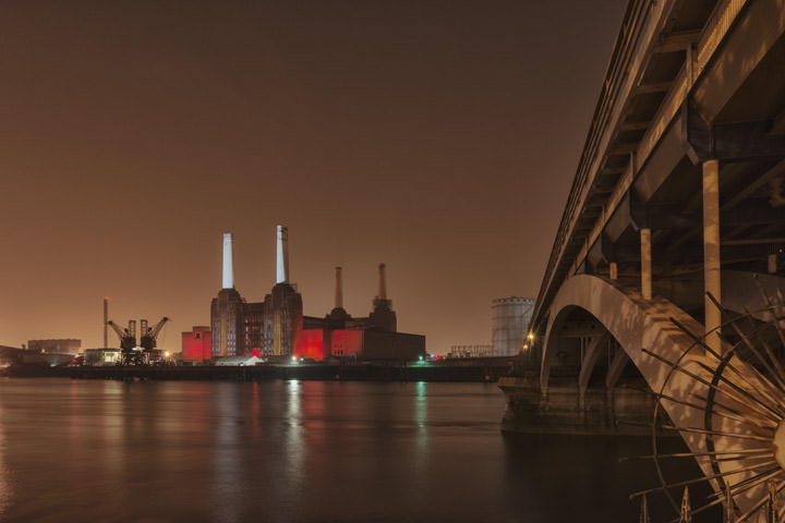 Battersea Power Station lit in red and white and Grosvenor Bridge  at Night