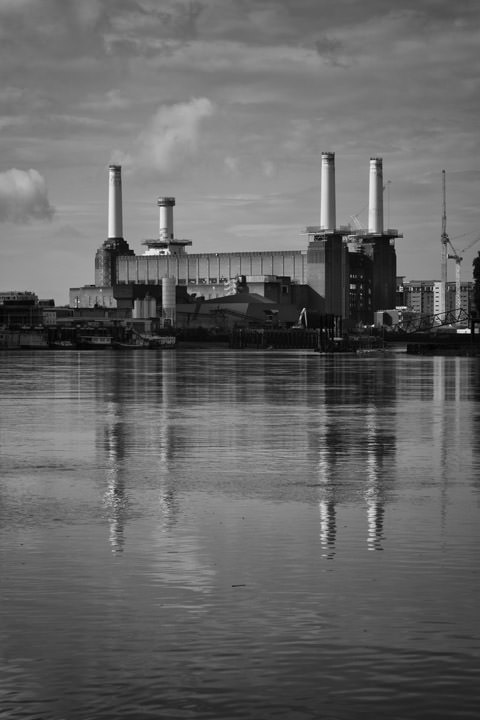 Battersea Power Station in black and white under patterned sky