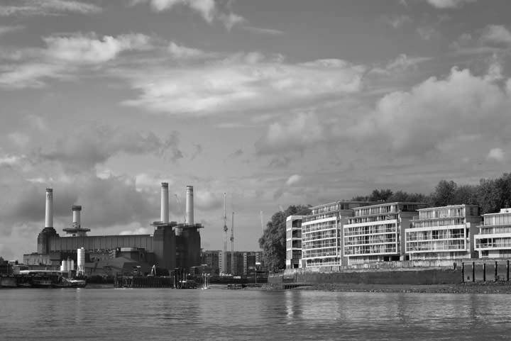 Battersea Power Station  under a cloudy sky in black and white