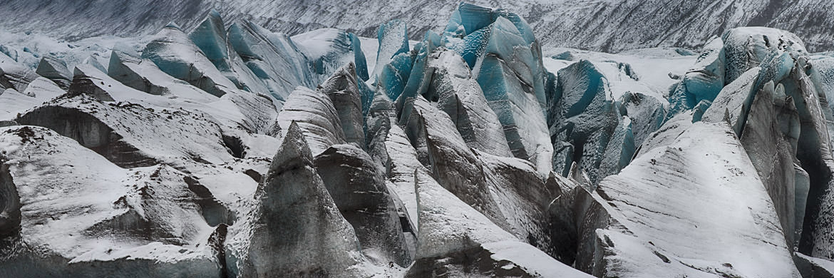Blue ice patterns in a glacier in Iceland.