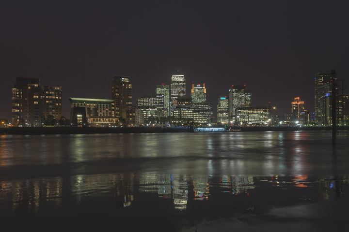 A night scene of Canary Wharf viewed from Rotherhithe