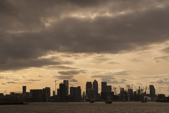 A Canary Wharf Cityscape silhouetted against yellow skies