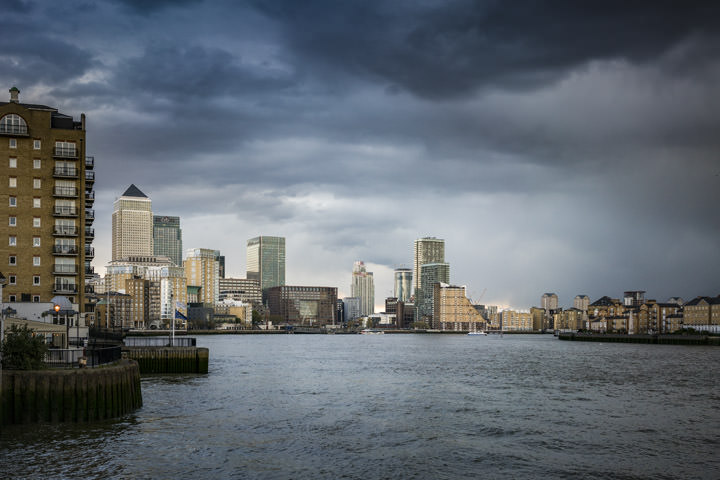 The Canary Wharf Skyline viewed from the River Thames on a stormy day
