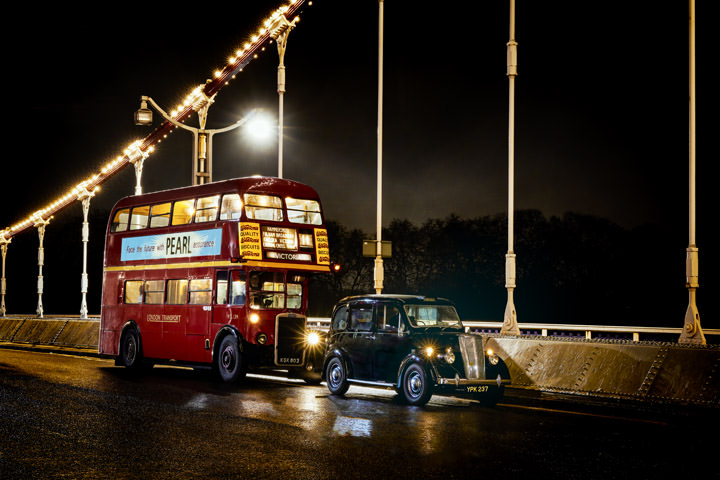 Vintage red bus and vintage taxi on Chelsea Bridge in London