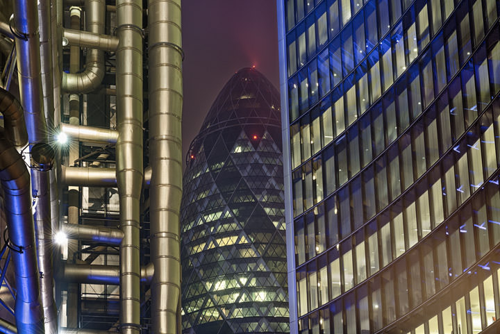 City of London Buildings illuminated at night.