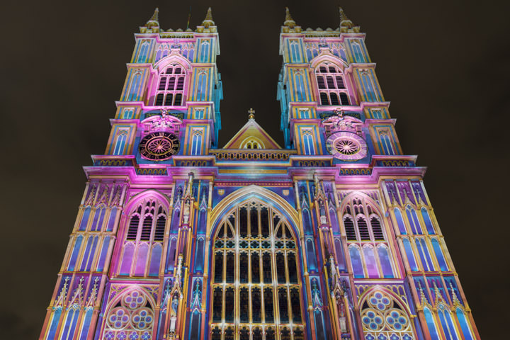 Westminster Abbey illuminated in pink and blue for a seasonal light show