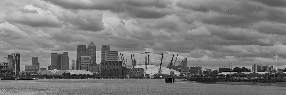 Moody Docklands Panorama shot on a cloudy day.