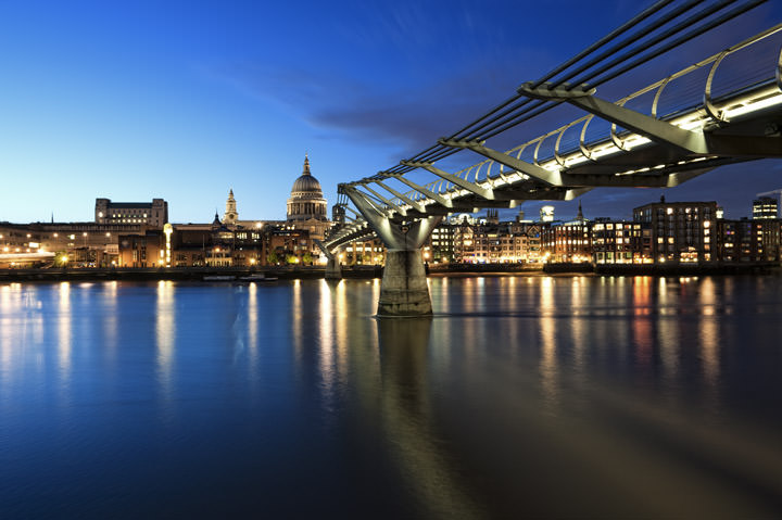 Dusk at St Pauls Cathedral and the Millennium Bridge against deep blue skies