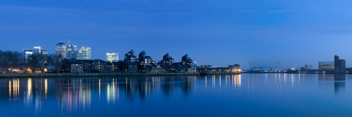 First Light at the East Greenwich waterfront with distant Isle of Dogs
