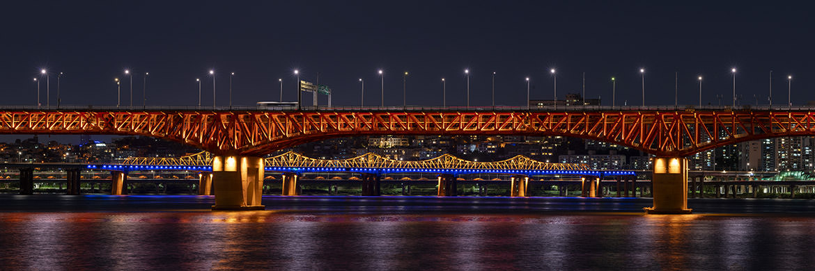 Han River Panorama at night with brightly lit bridges