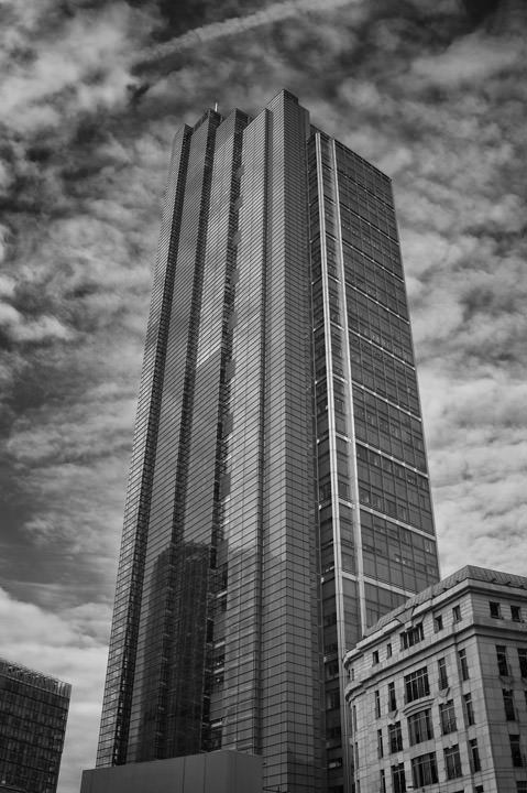 Heron Tower on a cloudy day in black and white.