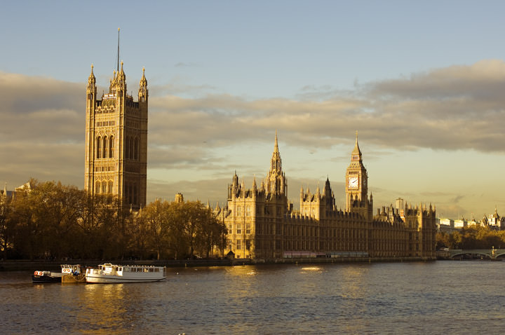 Houses of Parliament  viewed from the River Thames under golden evening light