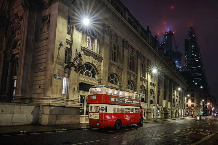 Vintage red London bus on Cornhill in London