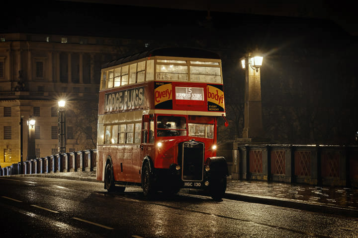 Vintage London Bus in the mist on Lambeth Bridge