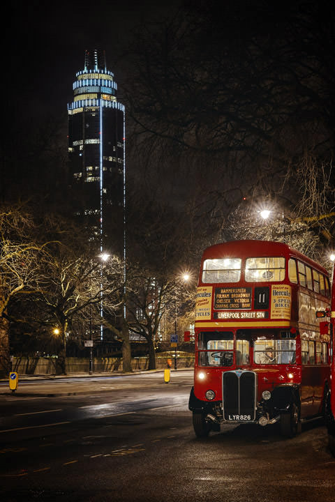 London Bus in front of  St Georges Tower at night