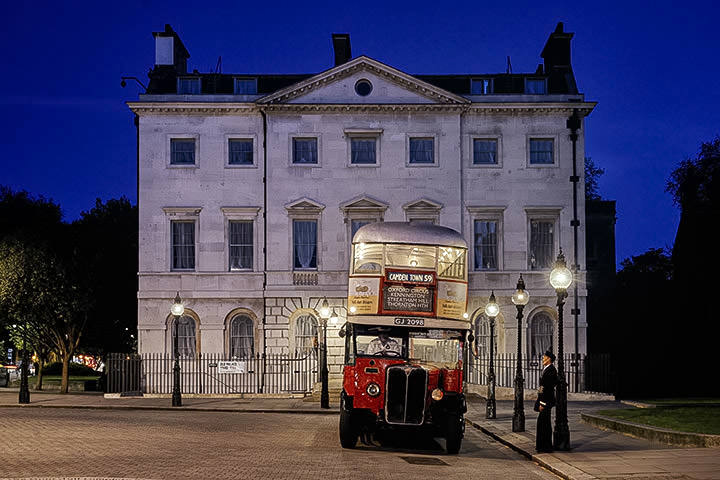 Vintage London Bus at dusk in Westminster