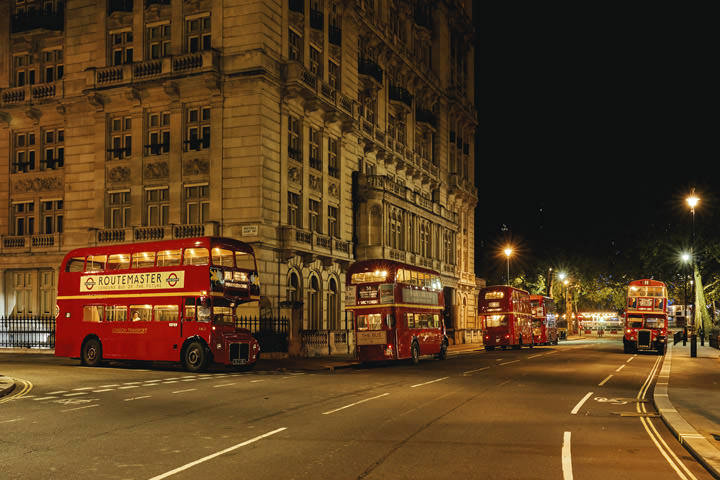 Five London buses at Westminster in London
