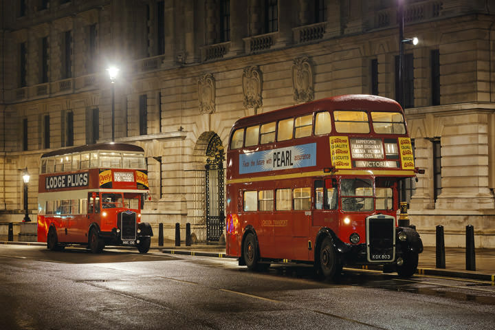 Two vintage London buses at Westminster in London