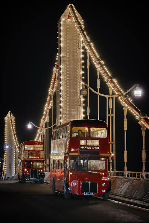 Two vintage London buses on Chelsea Bridge