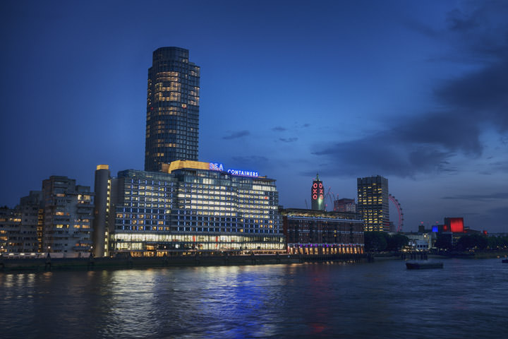 Mondrian Sea Containers and Oxo Tower under blue sky at dusk