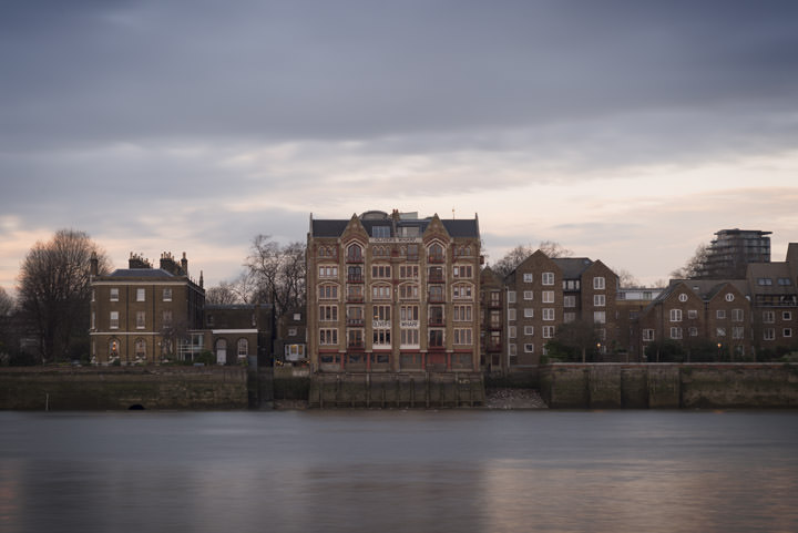 Olivers Wharf and the River Thames at dusk on a stormy day at Wapping in Tower Hamlets