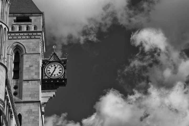 Black and white photo of the clock at the Royal Courts of Justice Fleet Street