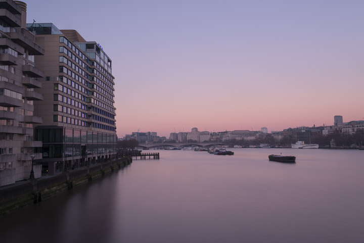 Sea containers House now the Mondrian Hotel on the River Thames at Southwark under beautiful pink skies of sunrise