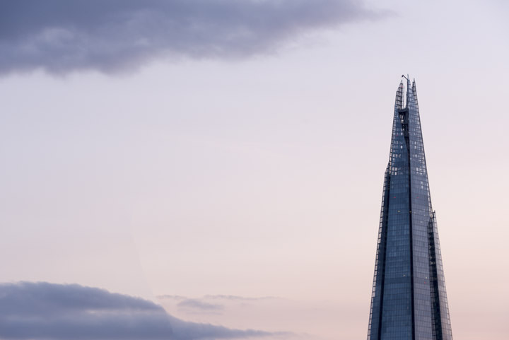 The top of the Shard in a pink sky