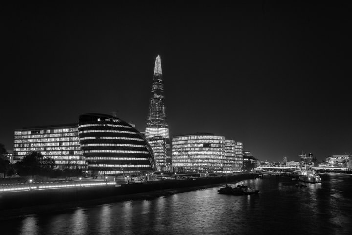 Shard and More London at night in black and white