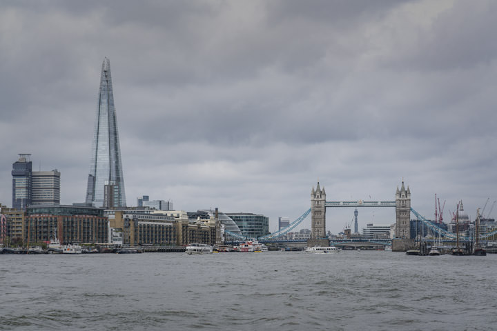 The Shard and Tower Bridge from the River Thames on a cloudy day