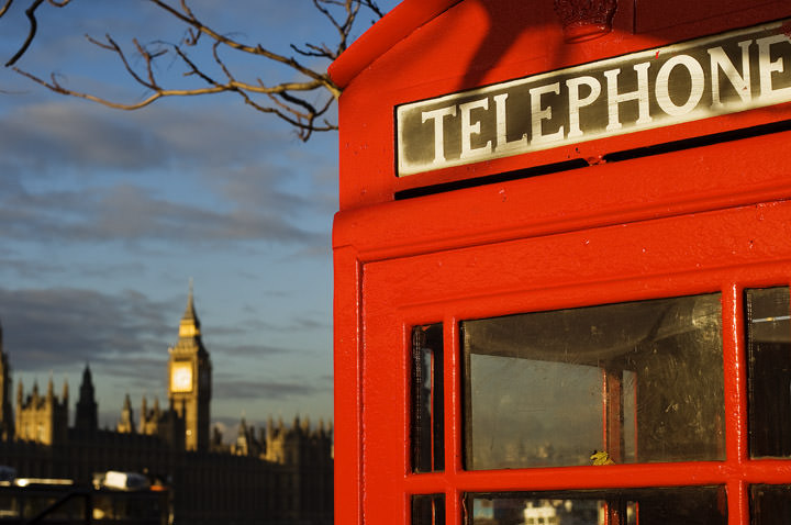 A red London Telephone Box with Big Ben in the background