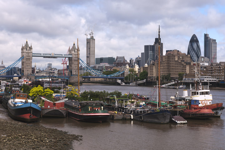 Tower Bridge and Houseboats viewed from River Thames at Southwark