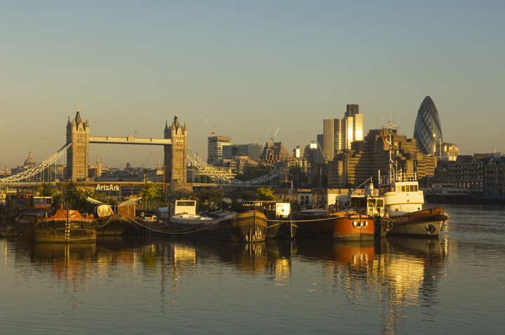 House boats and Tower Bridge viewed from River Thames at Bermondsey