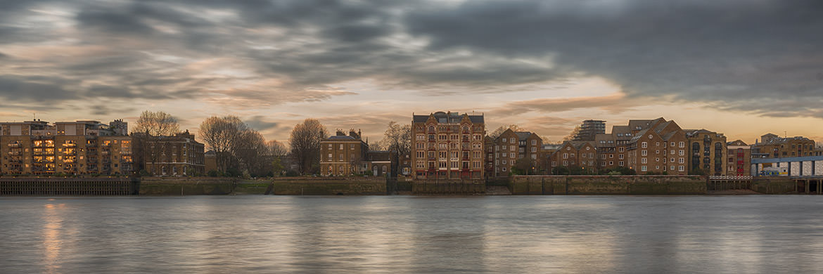 A panoramic picture of The River Thames waterfront at Wapping  in Tower Hamlets