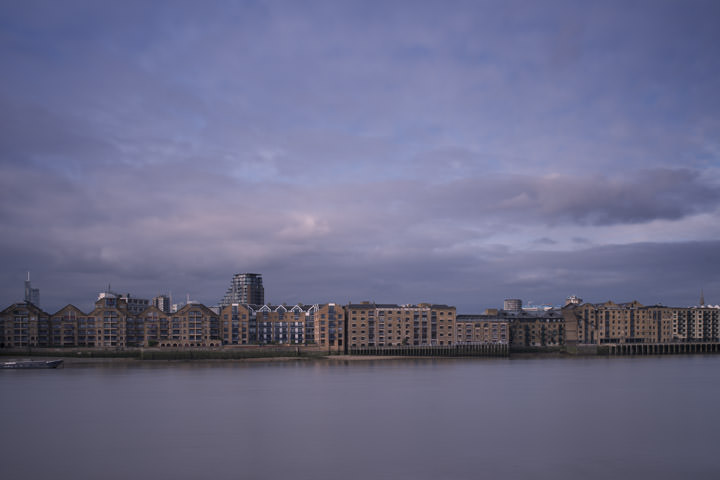Wharves at Wapping along the River Thames at Tower Hamlets in purple skies