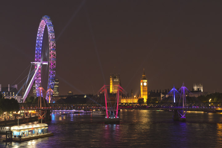 The London Eye, Houses of Parliament and Golden Jubilee Bridge brightly lit at night